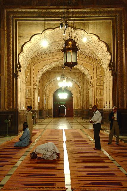 Muslim Men Praying Inside Badshahi Mosque in Lahore  PunjabInside Badshahi Mosque