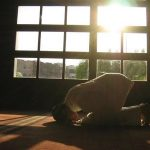 Man Praying & Sun Rays