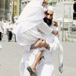 Son Carrying Mother to Friday Prayers (Madinah, Saudi Arabia)
