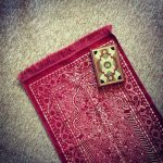 Mushaf and prayer mat