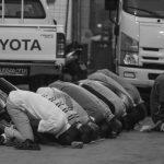 Men praying on the street in Djibouti